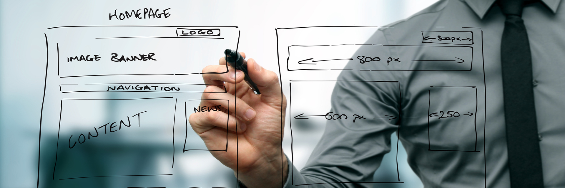Web Designer drawing rough draft of website